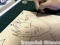 L'animateur dessine sur la feuille transparente, placée sur le dōga